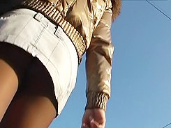 Spy upskirt of chick in black thong