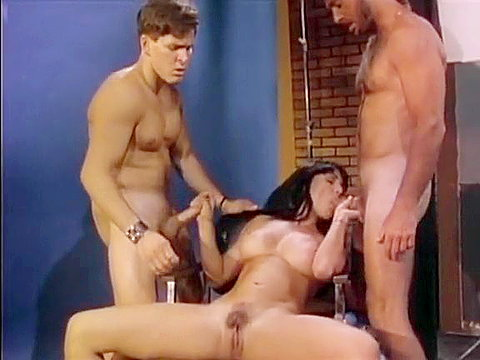 1 Nasty slut works on two big cocks in 1970s porn