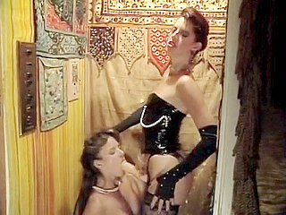 1 Old school porn star fucks a chick with strap on