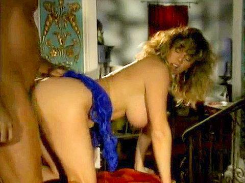 Bosomy girl plays lustful queen in 70s porn