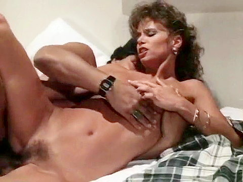 Vintage porn video of a sexy couple fucking