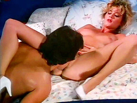 Young horny couple in a classic porn video
